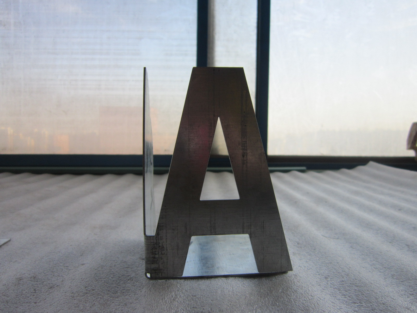 Decorative letter laser cut and bent, galvanized sheet