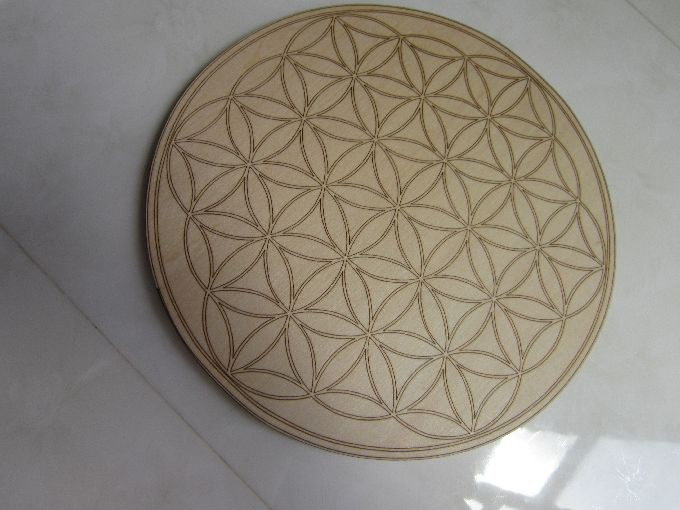 Round plywood laser cut and engraved. Flower pattern