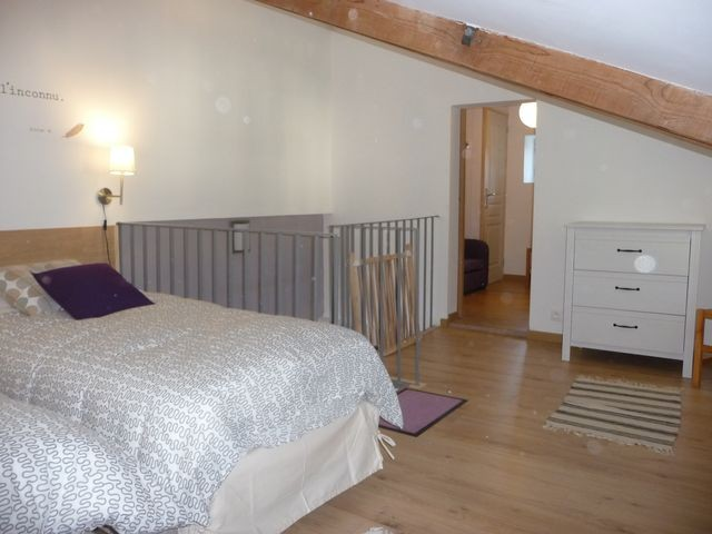 Upstairs bedroom one large double or 2 single beds
