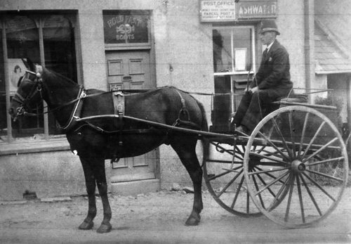 Postman outside R H Moon's Stores at Ashmill (Photo courtesy Margaret May Yates)