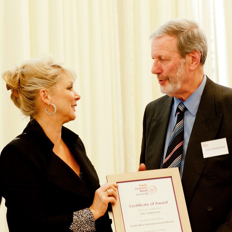 Colin receiving his Individual Learner Award from Cheryl Baker