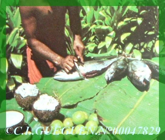 Préparation du Poisson au lait de coco...Vieille photo.