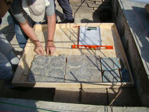 Les carreaux sont déposés dans des bacs (Socra, 2012)