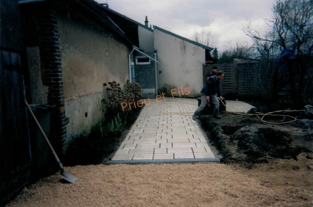 Terrasse, allée, entrée avec des dalles