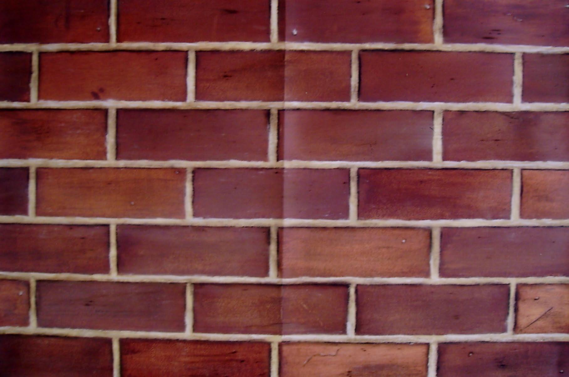 Effet de briques en trompe l'œil sur toile à maroufler