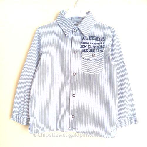 vetement enfant occasion. Vêtement enfant pas cher. Chemise rayée Tape à l'œil pas chère pour garçon de 8 ans. Couleurs bleu et blanc avec manches retroussables