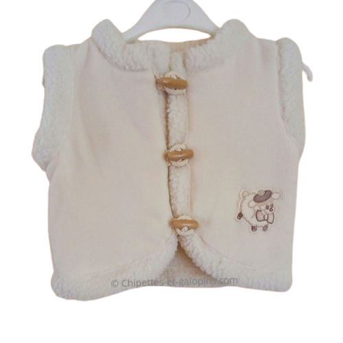 vetement bébé occasion. vetements bébé pas chers. Gilet polaire style berger sans manches couleur ivoire 12 mois