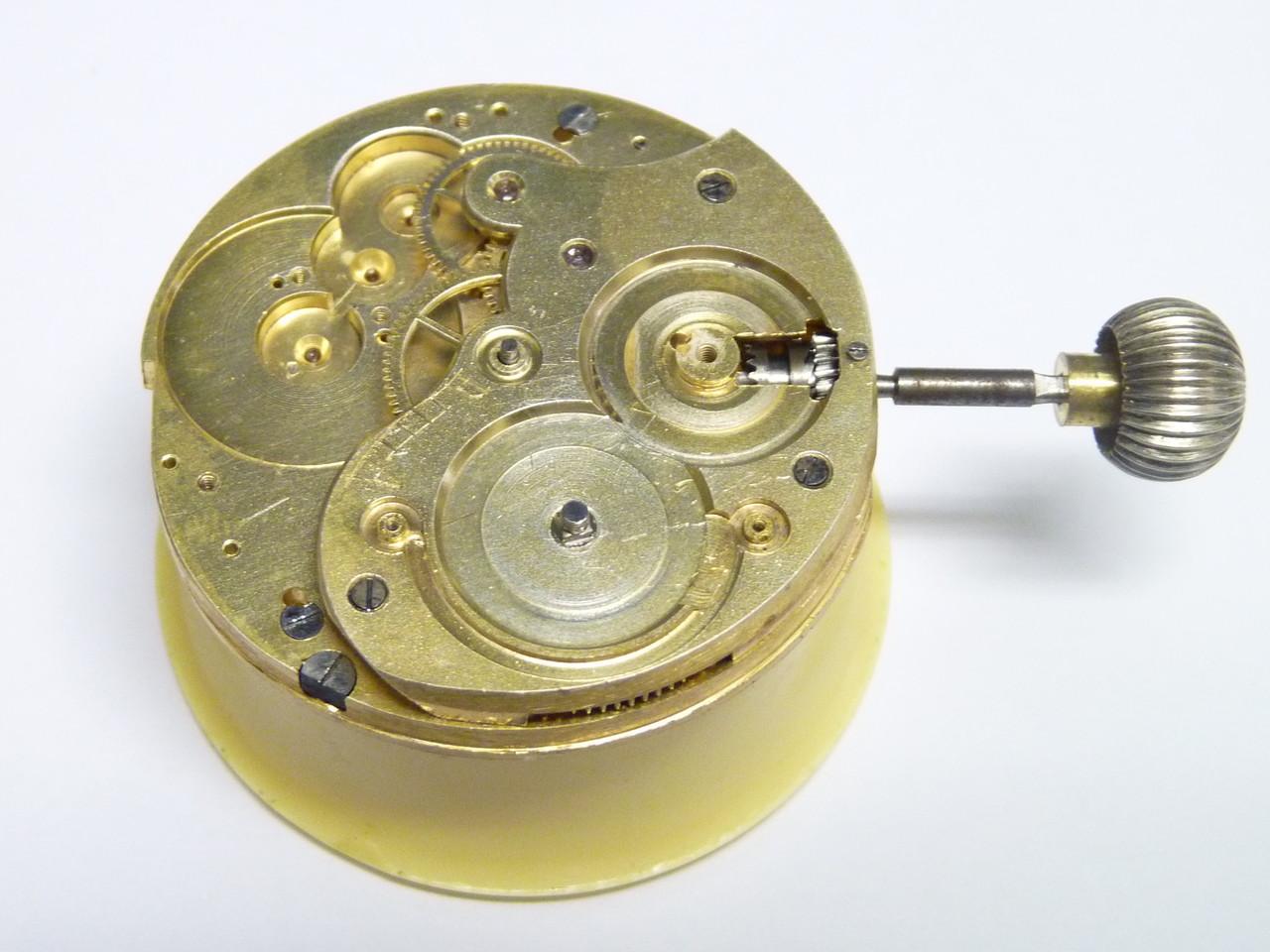 5.- Inici del muntatge-lubrificació del remontoir, roda cub i part del rodatge amb el seu pont