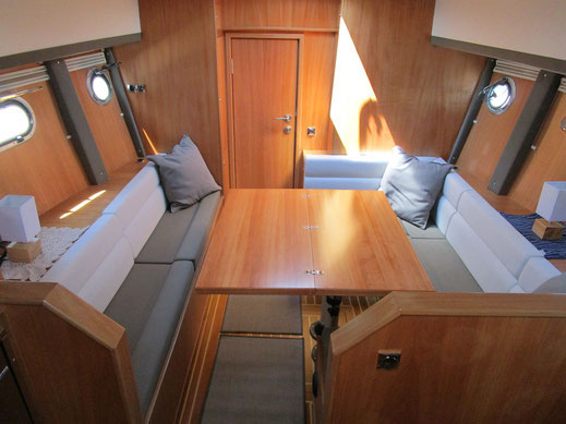 Salon of the fuel efficient motor boat with space for 6 adults