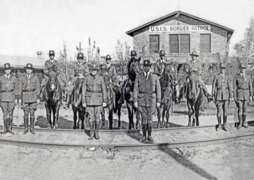 El Paso, Texas 1927 U.S. Immigration Service Border Patrol inspectors in formation in front of the Border Patrol's first training facility in Camp Chigas.