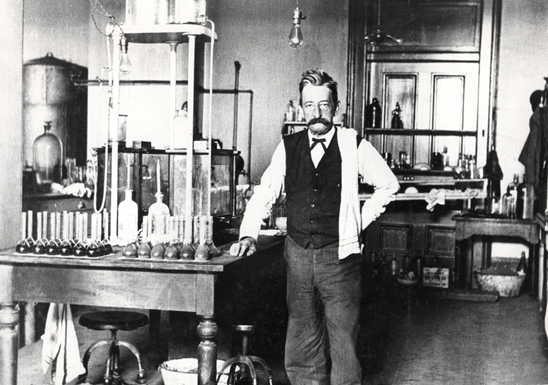 1906 - Chief Chemist Walter L. Howell stands in the laboratory in the U.S. Custom House in New Orleans, Louisiana. This Customs laboratory was established in 1900.