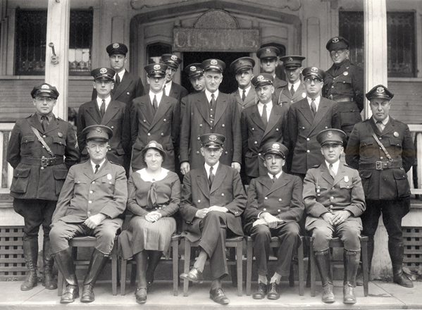 Derby Line, Vermont and Rock Island, Canada Border Crossing - Early 1930s Customs port director, inspectors, inspectress, and patrol inspectors sit for a portrait with the Immigration Service's immigrant inspectors and patrol inspectors on the steps of th