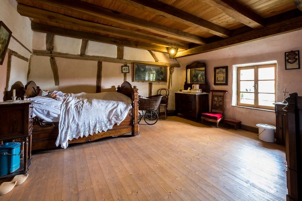 La chambre à coucher où tout la famille dort