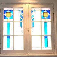 Vitrail pour 2 fenêtres faisant un rappel d'un autre vitrail du client