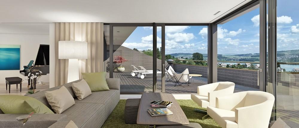 Herrlicher Ausblick aus dem Wohnbereich. Viel Privatsphäre auch dank den seitlichen Flügelwänden bei den Terrassen.