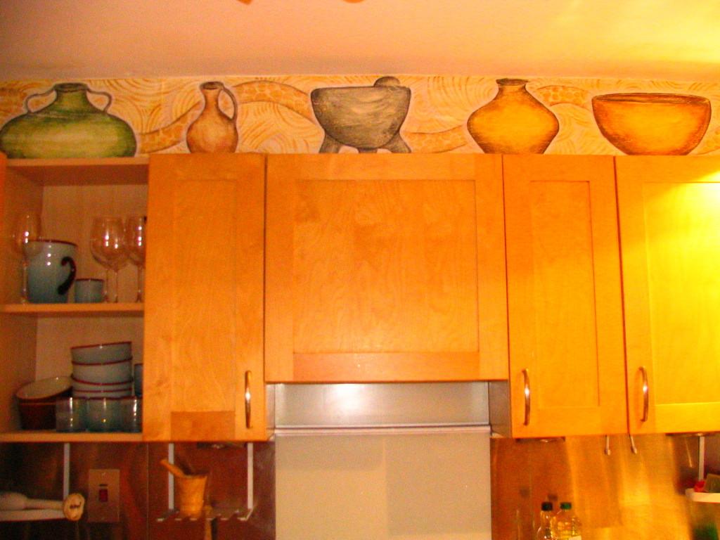 Pots on wall. Kitchen. Ireland 2007