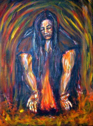 Eine Frau hütet ein Feuer.