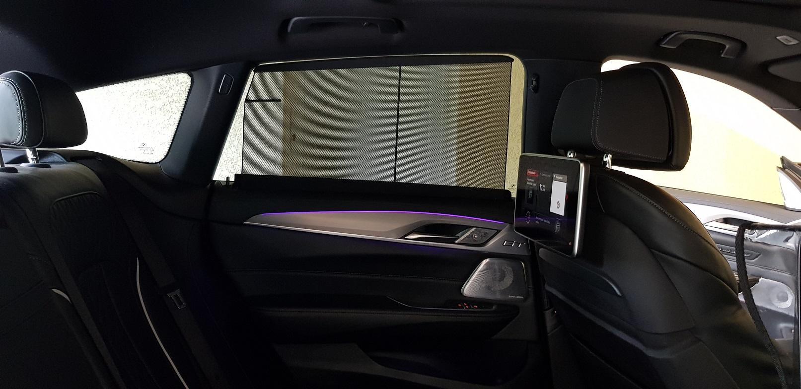 Places arrières BMW série 6 GT, stores et sièges électriques.