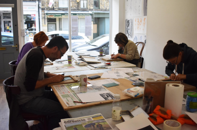 A group working on linocut at a linocut printmaking workshop