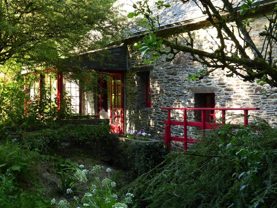 L'entrée du moulin et sa véranda ©moulindebeuzidou