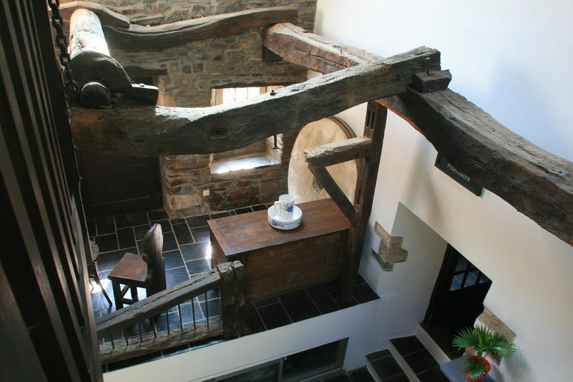 Vue depuis l'escalier, l'ancienne machinerie du moulin©moulindebeuzidou