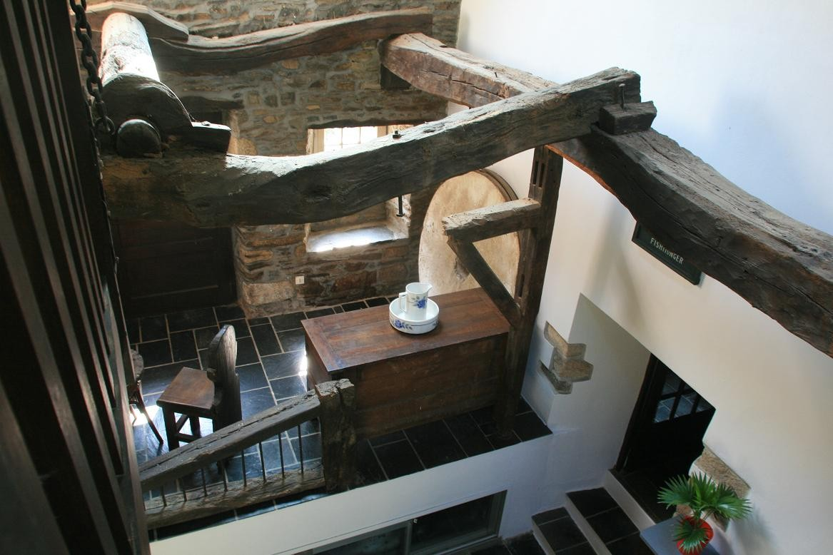 View from the stairs, the old mill machinery ©moulindebeuzidou