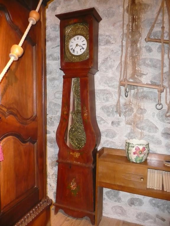 Horloge de parquet  balancier fleuri (état de marche garantie) 800€