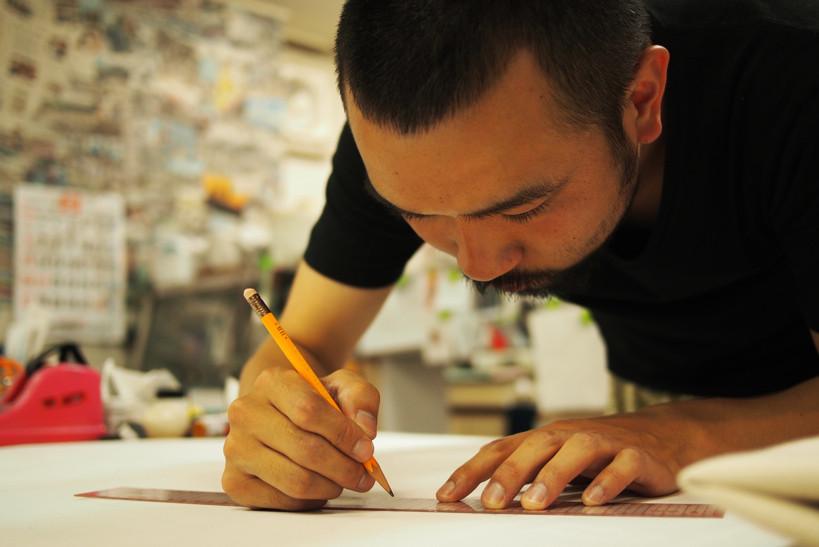 撮影担当の川西悠太。遊軍としてあらゆる仕事をこなす。
