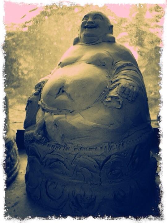 Lachender Buddha Modell für ein neues Bienenhaus