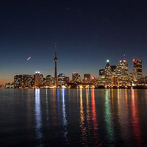 Toronto Skyline with CN Tower and illuminated Skyscrapers, Long Exposure, Night, Ontario, Canada