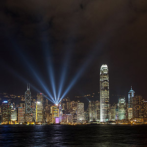 Hongkong, Kowloon Skyline with Iluminated Skyscrapers and Lasershow, Night, Long Exposure, Asia