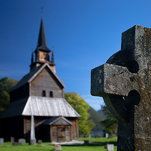 Cross & Church - a historical wood church and a stone cross, Norway, Scandinavia