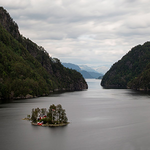 The House - solitaire house in a Fjord on a miniature island, Norway, Scandinavia