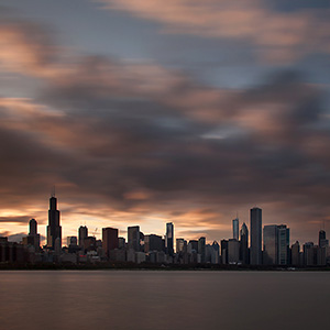 Chicago Skyline at the evening with dramatic colorful Clouds, Illinois, USA