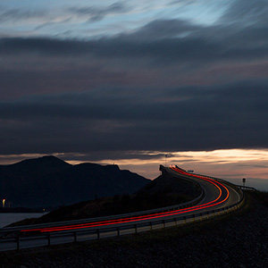 Atlantic Road Storseisund Bridge with red Car Light Trail, Molde, Norway, Scandinavia, Europe