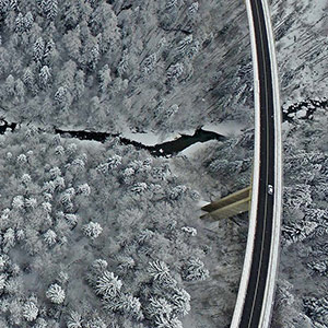 Icy Road and bridge with solo Car, DJI Phantom 3, Drone, Alps, Europe