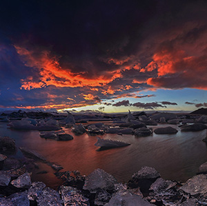 Fire & Ice - beautiful sunset with red and purple colors with icy Jokulsarlon Glacier Lagoon, , Scandinavia