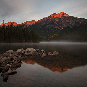Pyramid Lake sunrise with glowing Mountain Summits, Jasper National Park, Alberta, Canada