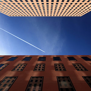 IGM Building with Reflecting Facade and Plane Trail, Blue Sky, Frankfurt Skyline, Germany, Europe
