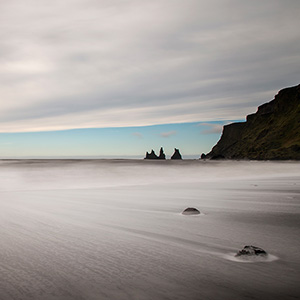 Out of time - rocks at the beach in Vik i Myrdal with long exposure, Scandinavia