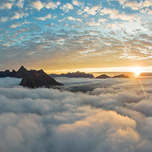 Aerial Panoramic at Sunset with Mountain Tips and Clouds with Drone, Lofoten Islands, Norway, Europe
