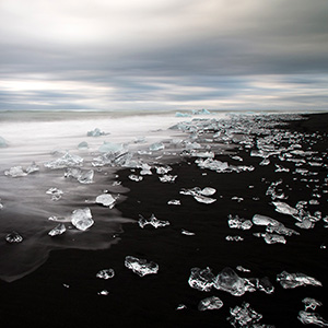 Diamond Beach - broken ice pieces at a black lava sand beach close to Jökulsarlon Glacier Lagoon, Iceland, Scandinavia