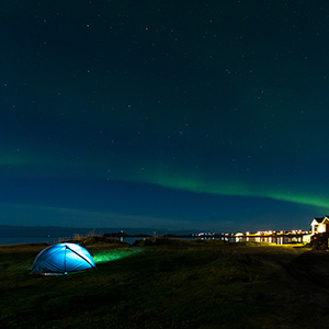 The Tent, Aurora Borealis, Northern Lights at a camping site with cabins and a tent, Lofoten Islands, Norway, Scandinavia