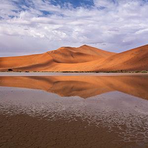 Desert Lake, water and san dunes in Sossusvlei, Namib Desert after rain, Namibia, Africa