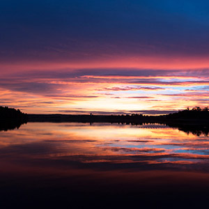 Variations of Red,and Blue, sunset at a lake with reflections close to Hundiksvall, Sweden, Scandinavia