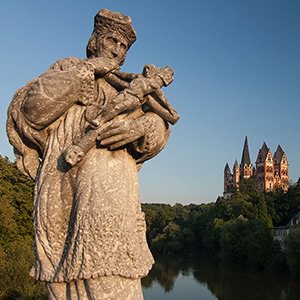 Beautiful Limburger Dom and a statue at a bridge, Lahn River, Limburg, Germany