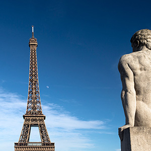 Eiffel Tower View, Musee de ' Homme, stone statue looking to the Eiffel Tower, Paris, France