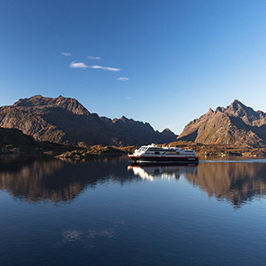 Hurtigruten, formerly a supply vessel now also cruise vessel at the Troll Fjord, Norway, Scandinavia