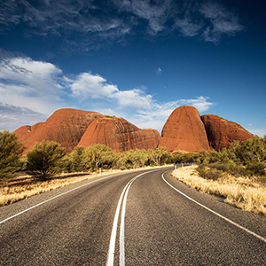 Rod to Olgas, Kata Tjuta with rainclouds in the Outback, Northern Territory, Australia