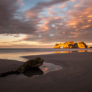 Wharariki Beach at Sunset with Bizarre Rocks and Clouds, Southern Island, New Zealand, Pacific Ocean